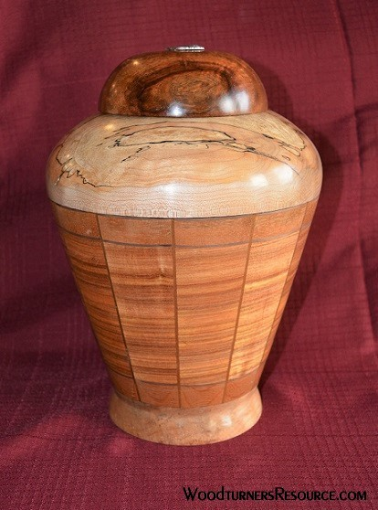 Canary wood cremation urn.
