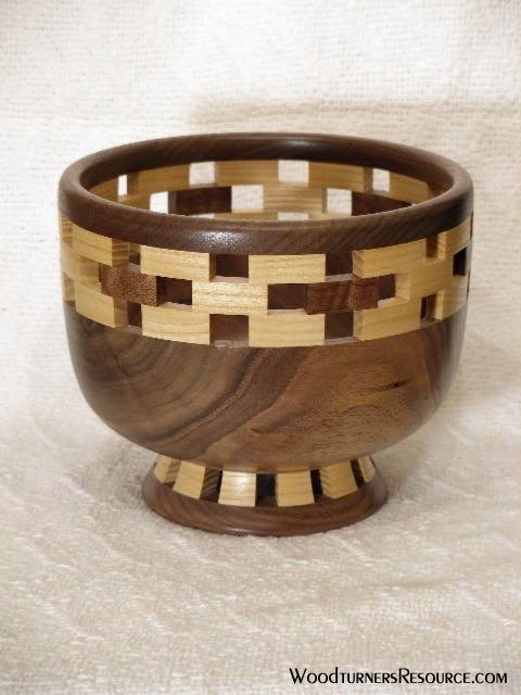 Walnut bowl w/ open seg rim & foot